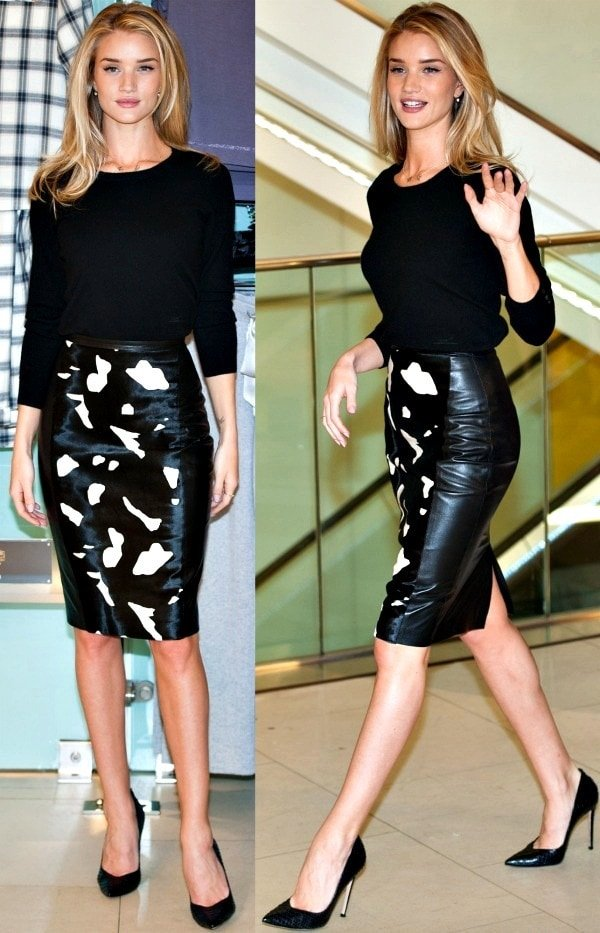 "Rosie Huntington-Whiteley wore a black cashmere top tucked into a black leather skirt. She completed her look with black ""Edgile"" pumps from Gianvito Rossi"