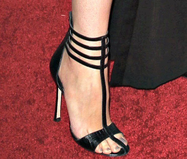 "Stana Katic wears a pair of ""Zoe"" sandals on her pedicured feet"