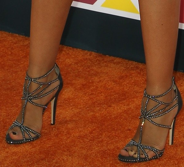 Tia Mowry-Hardrict wearing crystal-embellished strappy heels from Jimmy Choo