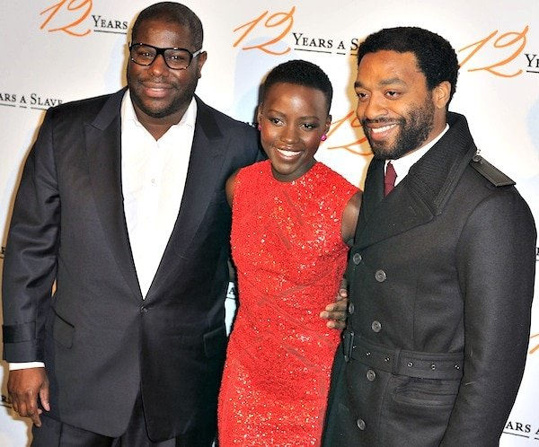 Lupita Nyong'o with director Steve McQueen and co-star Chiwetel Ejiofor at the premiere of 12 Years a Slave held at UGC Normandie in Paris, France, on December 11, 2013