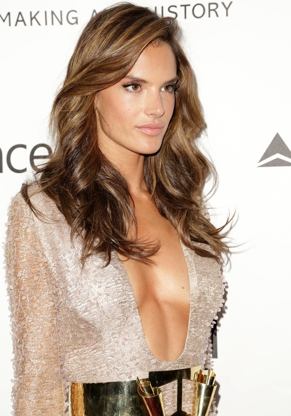 Alessandra Ambrosio donned an embellished side-slit gown by Hugo Boss paired with a runway gold-plated belt
