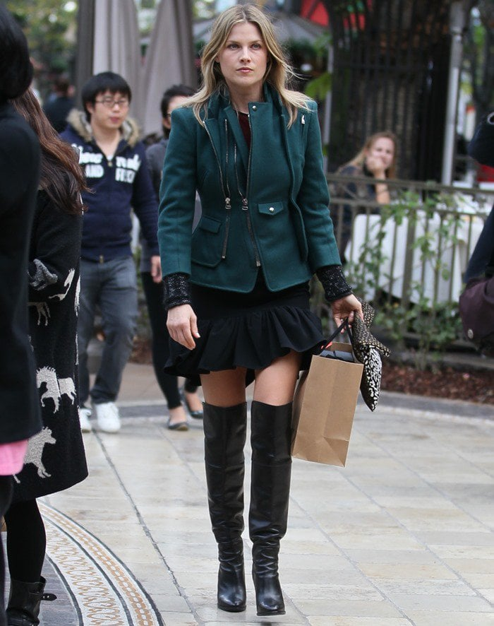 Ali Larter shopping in a short skirt and thigh-high boots
