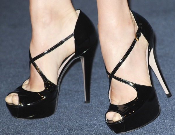 "Amy Adams in Gucci's ""Lili"" platform sandals, which feature crisscross front straps and black patent leather"