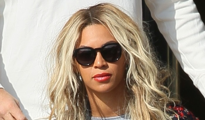 Beyonce covers her eyes with a large pair of sunglasses during a shopping trip