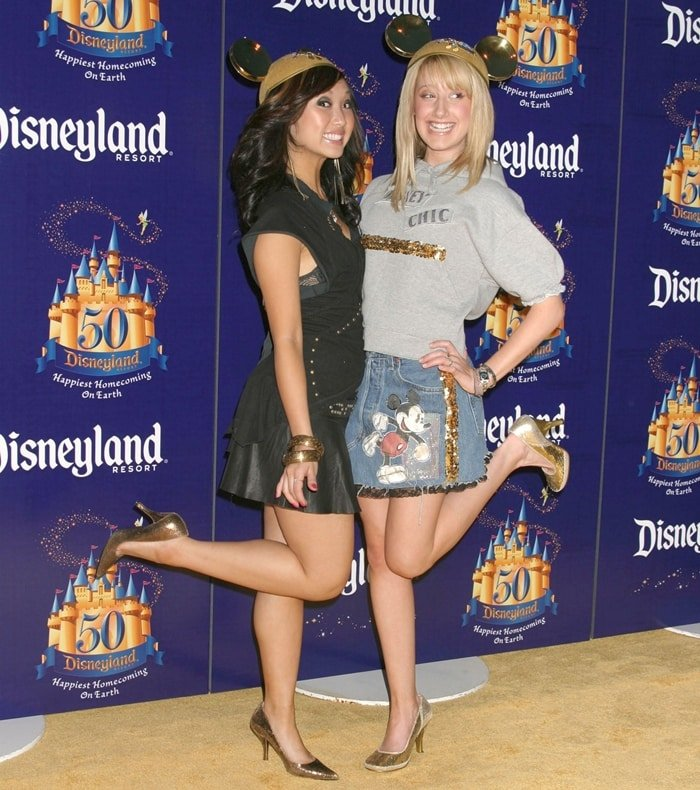"""Brenda Song and Ashley Tisdale are seen attending the """"Gold Carpet"""" arrivals on Main Street U.S.A. during the Disneyland 50th Anniversary Celebration"""