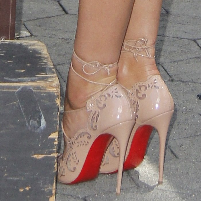 Candice Swanepoel shows off her feet in Christian Louboutin's Impera laser-cut pumps