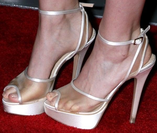 "Kate Mara wearing Charlotte Olympia ""Pomeline"" platform sandals"