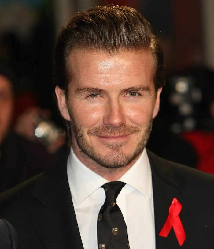 "David Beckham poses for photos at the premiere of ""The Class of '92"""