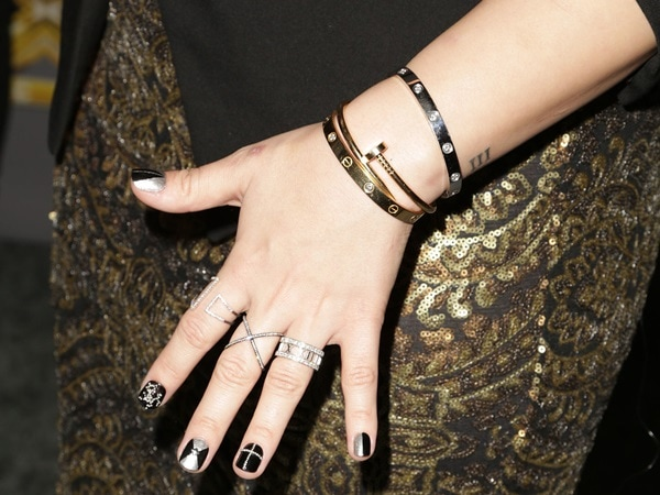 Demi Lovato showing off her Cartier love bracelet