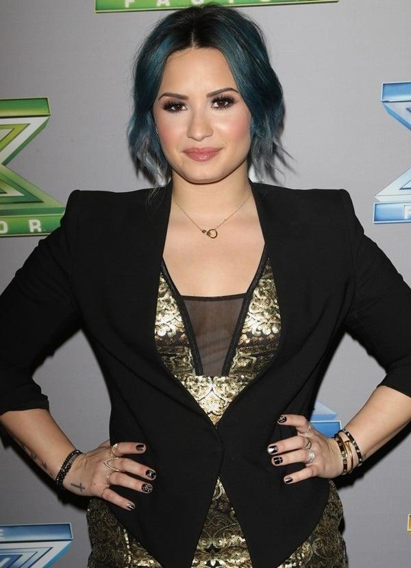 Demi Lovato wearing a Smoking tux blazer by Helmut Lang