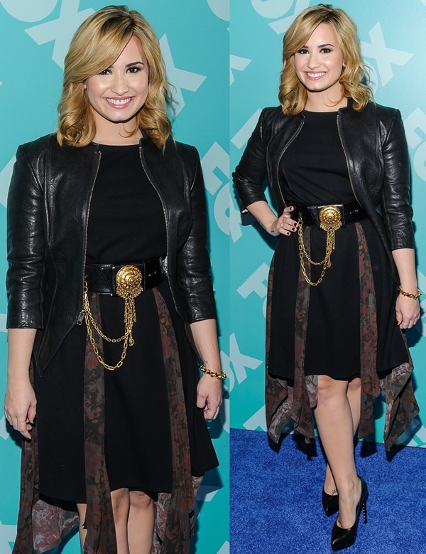 Demi Lovato in a black dress and a leather jacket