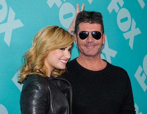 FOX Demi Lovato and Simon Cowell at the FOX 2013 Upfront Presentation post-party at Wollman Rink in Central Park, New York City, on May 13, 2013