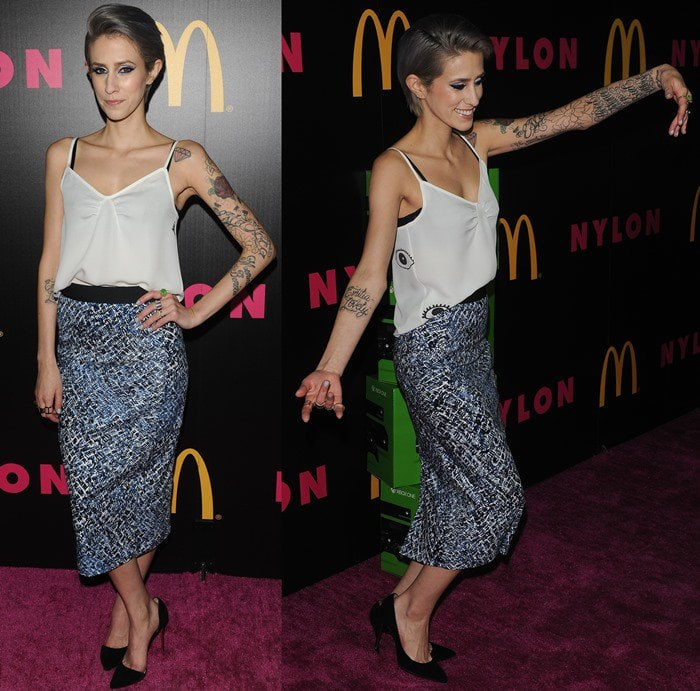 Dev in a ladylike outfit at the Nylon December issue celebration at Smashbox in West Hollywood