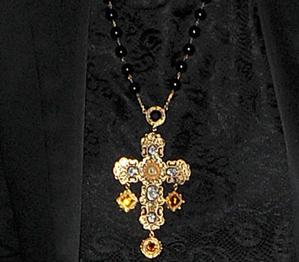 Rita Ora wearing a Dolce & Gabbana 'Sicilian' filigree rosary necklace