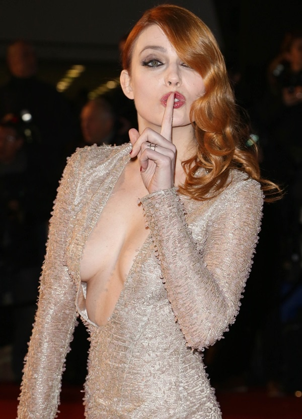 Élodie Frégé flashed her breasts in a champagne gold textured dress