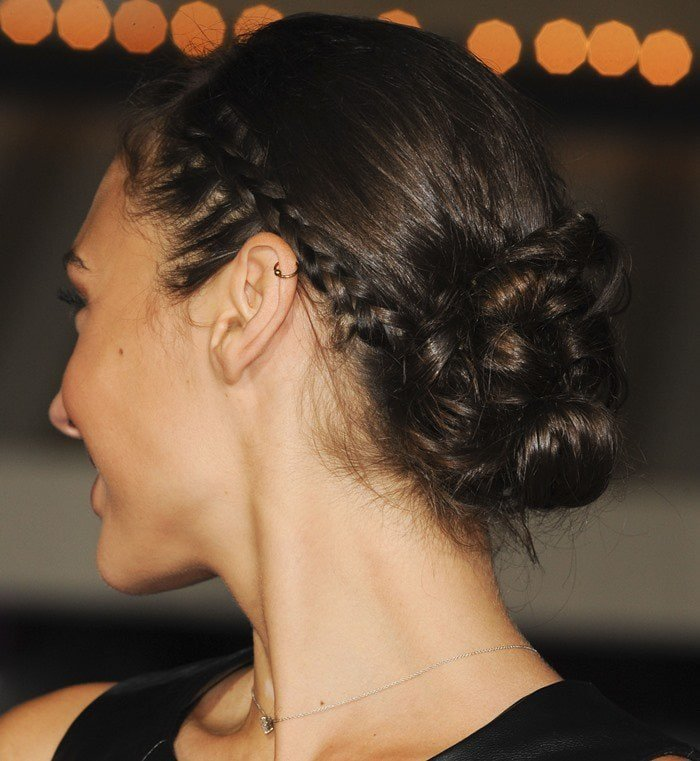 Gal Gadot styles her hair back into braids