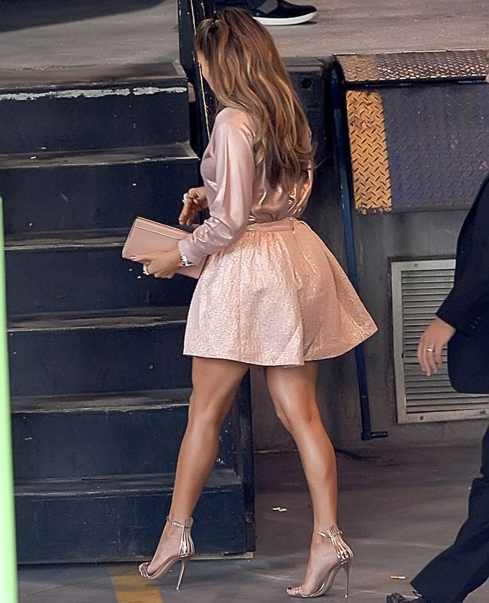 "Jennifer Lopez showed off her toned legs in Kate Spade New York's ""Aimee"" metallic textured pleat skirt in blush"