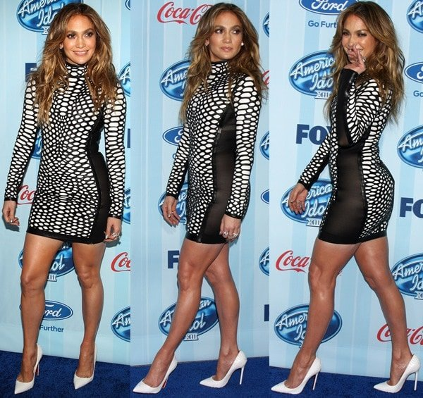 Jennifer Lopez wearing a fishnet dress and snake-print Christian Louboutin pumps to the premiere party of American Idol Season 13 at Royce Hall in Westwood on January 14, 2014