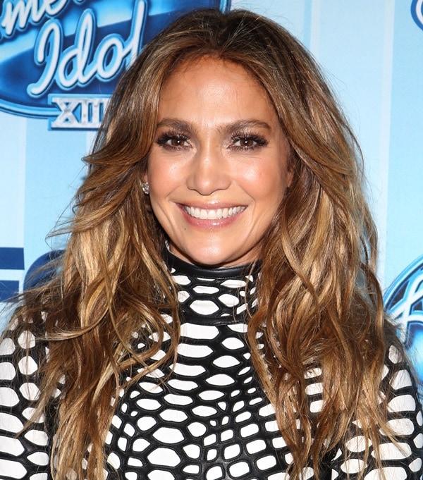 Jennifer Lopez wearing a fishnet dress