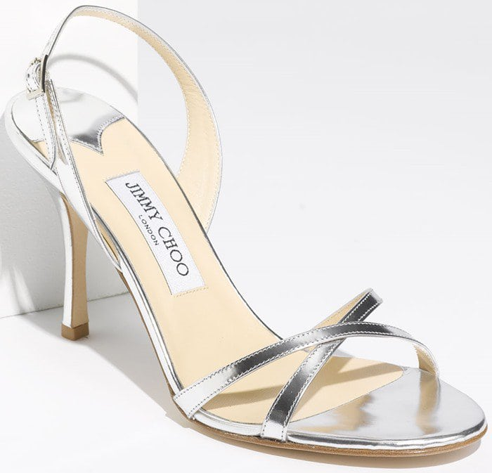 Glossy patent leather enhances the sleek, breezy design of a wonderfully versatile sandal set on a classic high heel.