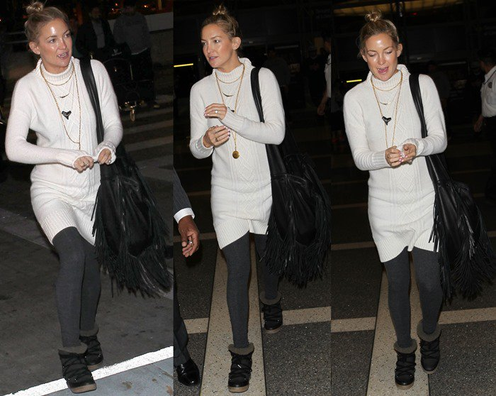 Kate Hudson walks through Los Angeles International Airport