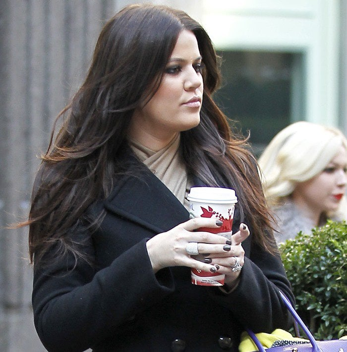 Khloe Kardashian wears a chic black peacoat dress in New York