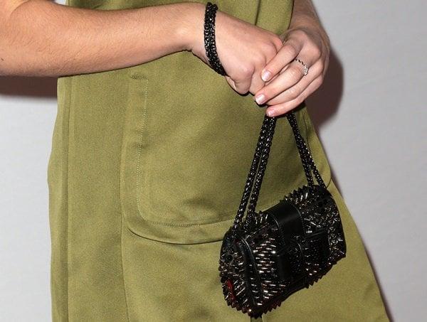 "Kiernan Shipka totinga Christian Louboutin ""Sweet Charity"" studded shoulder bag"