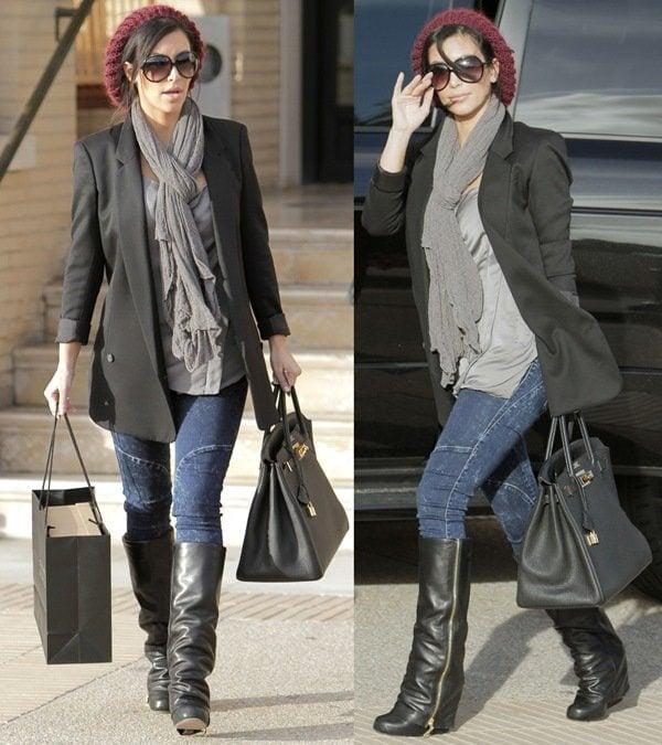 Kim Kardashian rockszippered Josey boots by Dolce Vita and moto jeans