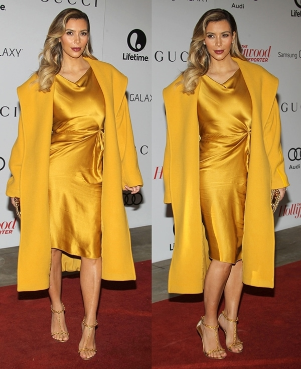 Dressed in a stunning yellow satin Lanvin dress and a Max Mara coat, Kim was a golden diva