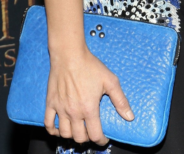 Kristen Bell accessorized with a studded blue leather iPad case