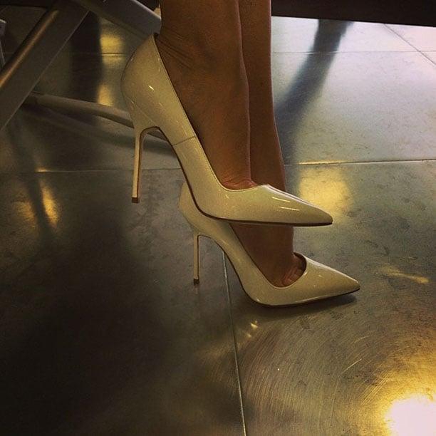 Kylie Minogue wearing white pumps