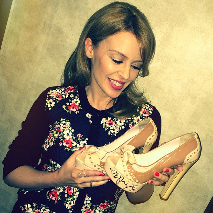 Kylie Minogue with the autographed shoes she donated to the Small Steps Celebrity Shoe Auction