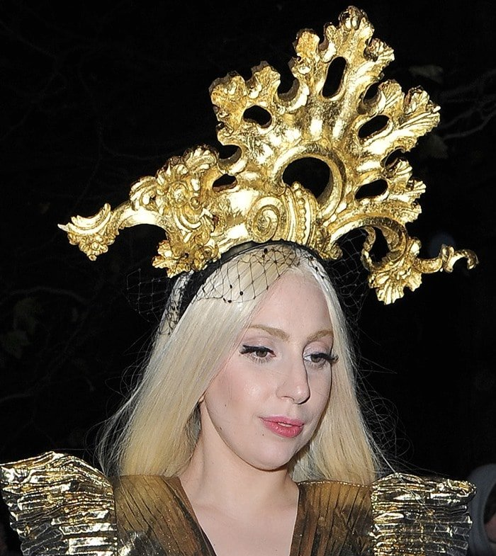Lady Gaga wearing a gold dress with a matching gold headpiece as she returns to her hotel in London on December 4, 2013