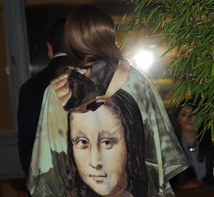 Lady Gaga exited the prestigious Langham hotel in London wearing a vintage mini dress featuring a screen-painted version of Leonardo da Vinci's famous half-length portrait of Mona Lisa