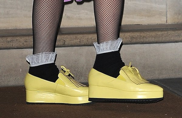 Lady Gaga styled her yellow shoes with black shoes and stockings