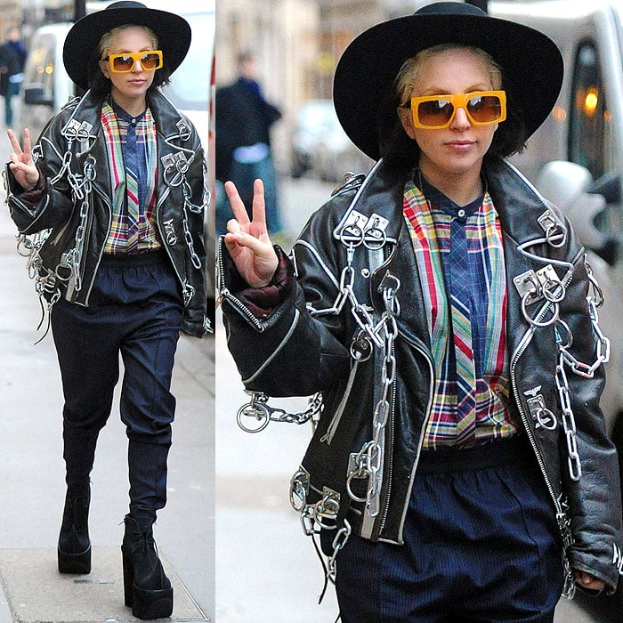 Lady Gaga sported a wide-brimmed hat, square-framed yellow sunglasses, and a black leather jacket laden with heavy metal rings and chains