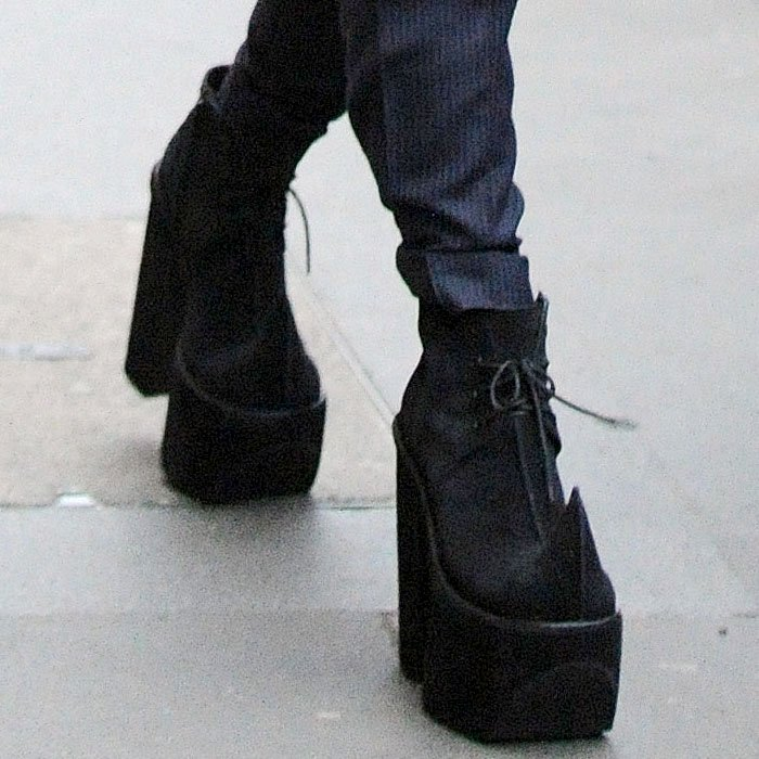 Lady Gaga wearing horn toe platform boots