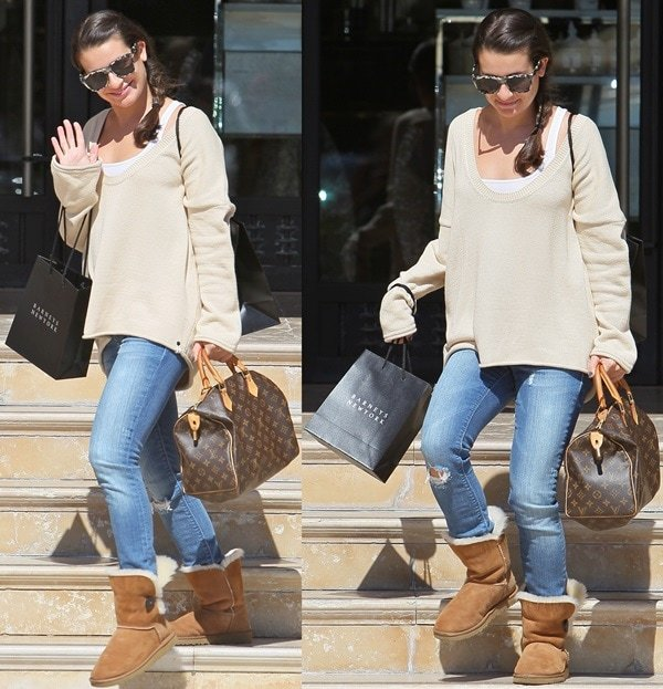 Lea Michele with her hands full as she leaves Barneys New York in Beverly Hills after shopping on October 7, 2011