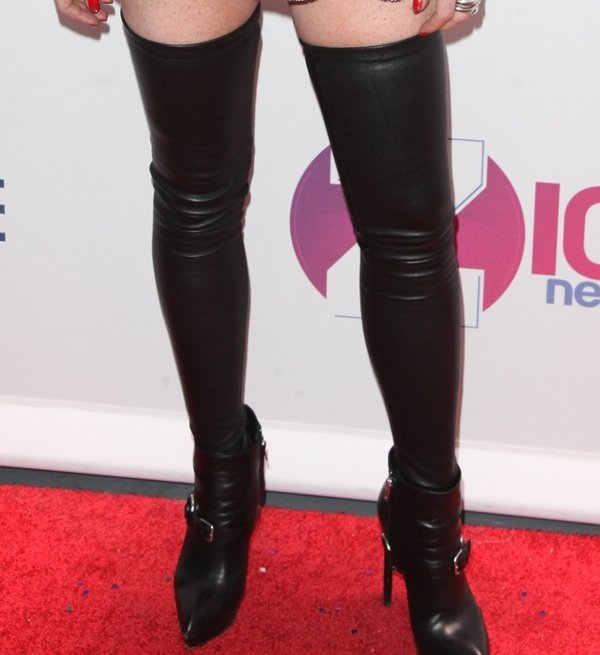Lindsay Lohan rocks thigh-high leather stockings by Samantha Myer