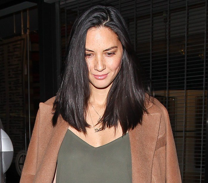 Olivia Munn wears her hair down as she goes out for dinner at Craig's