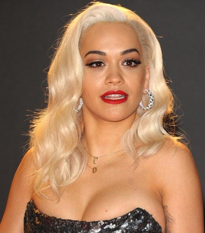 Rita Ora wears her blonde hair in soft curls at the 2013 British Fashion Awards
