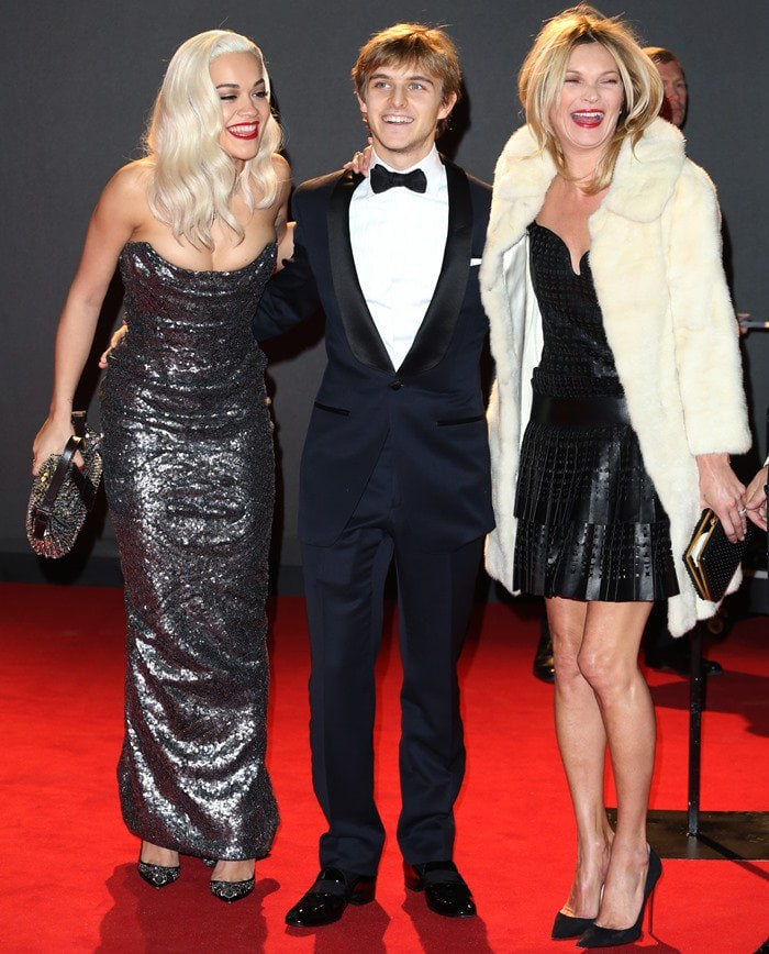 Rita Ora, Brandon Green and Kate Moss pose for photos on the red carpet of the British Fashion Awards