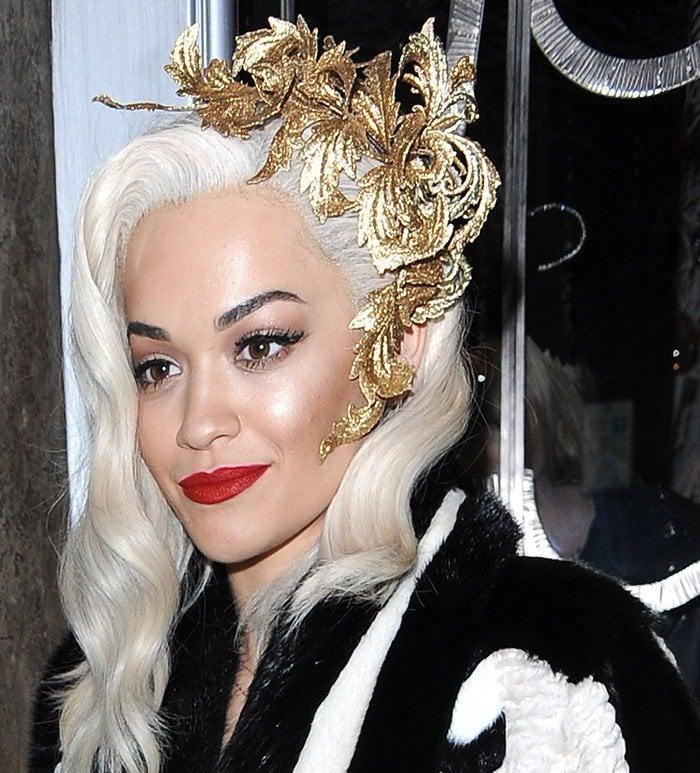 Rita Ora wears a headpiece from Philip Treacy