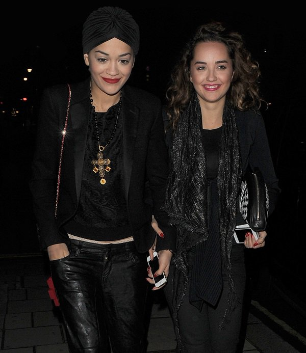 Rita Ora wearing a classic black silk and wool blazer by Saint Laurent and a DKNY paisley lace long-sleeve pullover