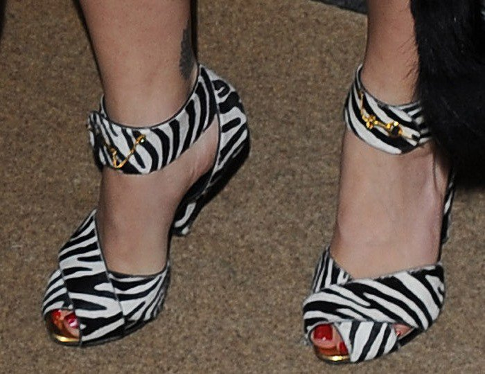 Rita Ora shows off her sexy toes in Tom Ford zebra print sandals