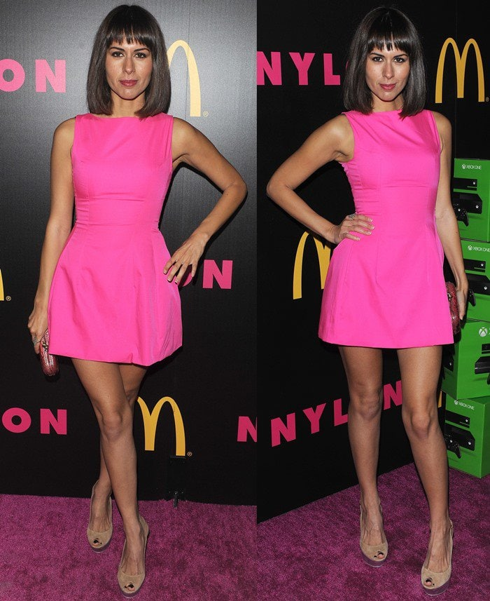 Sabina Akhmedova flaunts her legs in two-tone peep-toe pumps with platforms that blended with Nylon's purple carpet