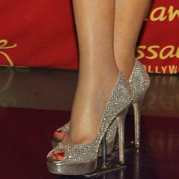 Selena Gomez wax figure feet and legs in glittering shoes