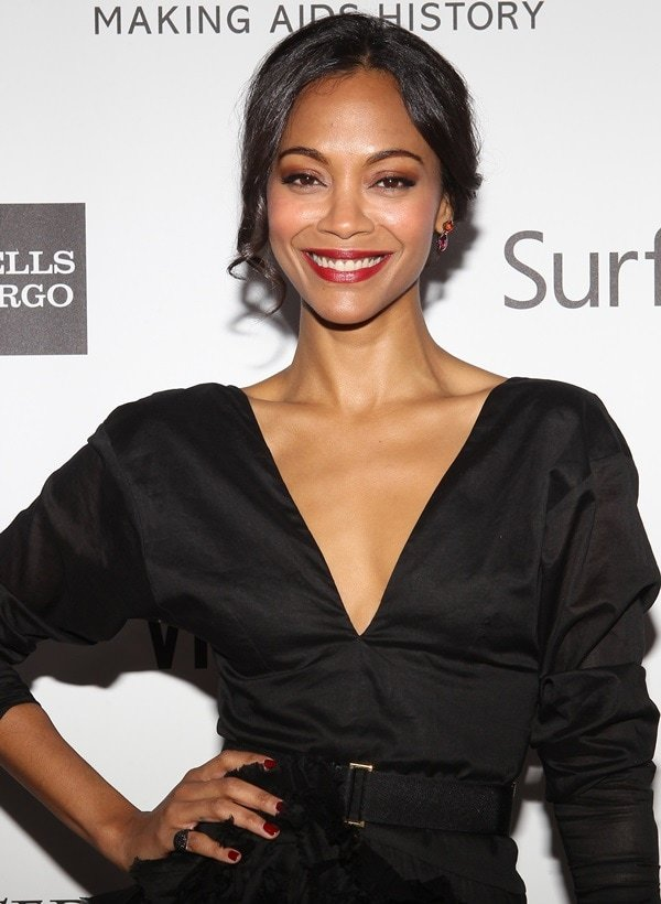 Zoe Saldana donned a black-belted peplum dress by Marni featuring asymmetrical layered ruffles and an open v-neckline