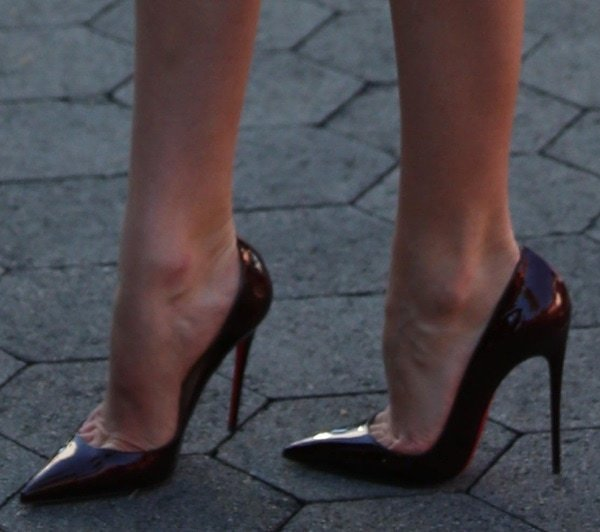 d4e0d0bb8758 Candice Swanepoel showing off her legs in Christan Louboutin
