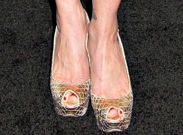 Carla Gugino shows off her feet in gold python slingback pumps